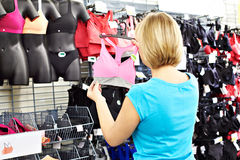 Woman chooses bra for doing sports Royalty Free Stock Image