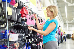 Woman chooses bra for doing sports Stock Images
