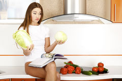 Woman chooses the cabbage Stock Images
