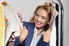Woman chooses clothes in clothes shop Stock Photo