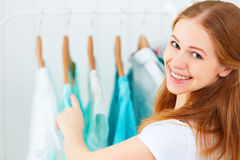 Woman chooses clothes in her wardrobe stock image