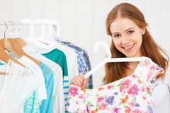 Woman chooses clothes in her wardrobe Stock Photo