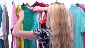 Woman chooses clothes in the wardrobe closet stock video footage