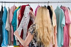 Woman chooses clothes in the wardrobe closet royalty free stock photography
