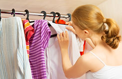 Woman chooses clothes in the wardrobe closet at home Royalty Free Stock Photos
