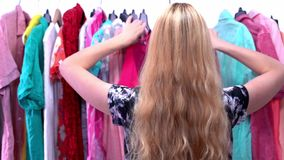 Woman chooses clothes in the wardrobe closet stock footage