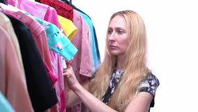 Woman chooses clothes in the wardrobe closet stock video