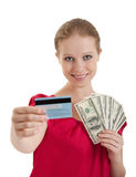 Woman chooses between credit card, cash money Royalty Free Stock Images