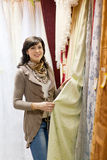Woman chooses the draperies Stock Photo