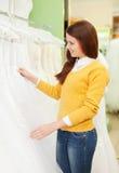 Woman chooses  dress at shop of wedding fashion Royalty Free Stock Photo