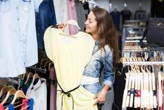 Woman chooses dress summer Stock Photos