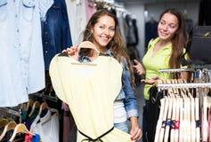 Woman chooses dress summer Royalty Free Stock Photos