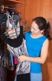 Woman chooses dress in wardrobe Stock Image