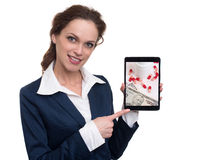 Woman chooses drugs online. Businesswoman holding a tablet computer - Woman chooses drugs online Stock Image