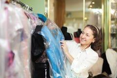 Woman chooses evening dress Royalty Free Stock Photo