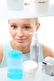 Woman chooses face cream. Stock Photography