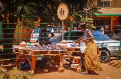 Woman chooses fish at the african street market in zambia royalty free stock images