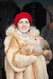 Woman  chooses fur coat Royalty Free Stock Photography