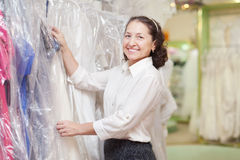 Woman  chooses gown at boutique Stock Images