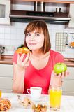 Woman chooses healthy diet. Young woman chooses healthy diet Royalty Free Stock Images