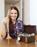 Woman chooses jewelry in  chest Royalty Free Stock Photos