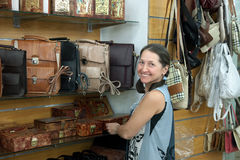 Woman chooses leather chest at  shop Royalty Free Stock Photo