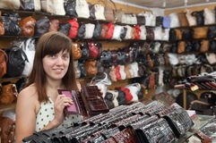 Woman chooses leather wallet Stock Photo