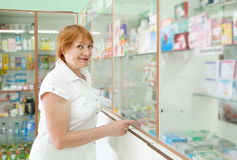 Woman chooses at the pharmacy Stock Image