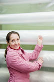 Woman chooses  polythene for hothouse Stock Image