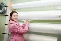 Woman  chooses polythene for hothouse Stock Photography
