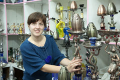 Woman chooses  sheesha in  shop Stock Photography