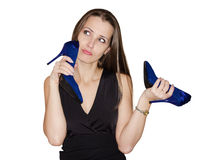 Woman chooses shoes Stock Images