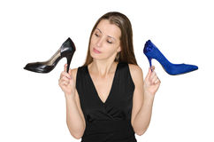 Woman chooses shoes Royalty Free Stock Photography