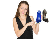 Woman chooses shoes Royalty Free Stock Image