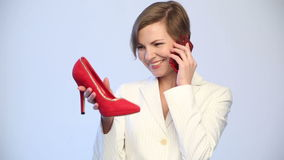 Woman Chooses Shoes. Phone Calls. Royalty Free Stock Photo