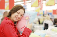 Woman chooses in shop. Sleeping linen royalty free stock photography