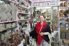 Woman  chooses souvenirs in egyptian shop Royalty Free Stock Images