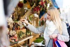 Woman chooses souvenirs Royalty Free Stock Photo