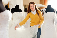 Woman chooses wedding gown Stock Images