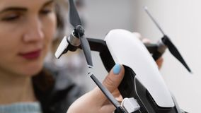 Woman chooses white selfie drone. In a hobby and toy store. Close up. Gender equality and women`s rights concept stock footage