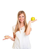 Woman Choosing Apple Over Puff Royalty Free Stock Photos