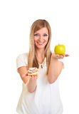 Woman Choosing Apple Over Puff Stock Photography