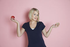 Woman Choosing Between Apple And Tart Royalty Free Stock Photo