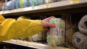 Woman choosing baby yarn inside Walmart store. Stock Images