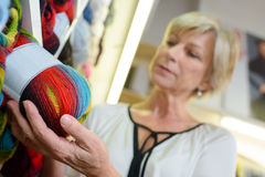 Woman choosing ball wool Royalty Free Stock Image