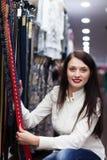 Woman choosing belt at shop Stock Photography