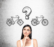 Woman choosing bicycle Royalty Free Stock Photo