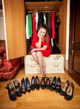 Woman choosing black high heeled shoes at wardrobe Stock Images