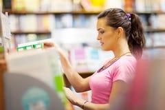 Woman choosing book Stock Photos