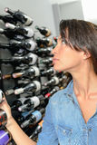 Woman choosing bottle wine Stock Photo